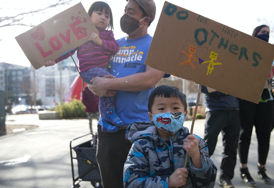 caption: Grayson Chan, 5, holds a sign that reads 'Do Not Hate Others,' while standing with his family during the 'We Are Not Silent' rally and march against anti-Asian hate and violence on Saturday, March 13, 2021, at Hing Hay Park in Seattle. Several days of actions are planned by rally organizers in the Seattle area following recent attacks and violence against Asian American and Pacific Islander communities.