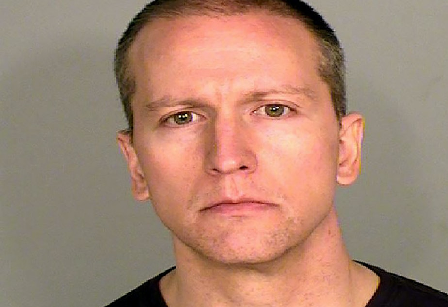 caption: Former Minneapolis police officer Derek Chauvin, who was captured on cellphone video kneeling on George Floyd's neck for several minutes, still faces a higher charge of second-degree murder.