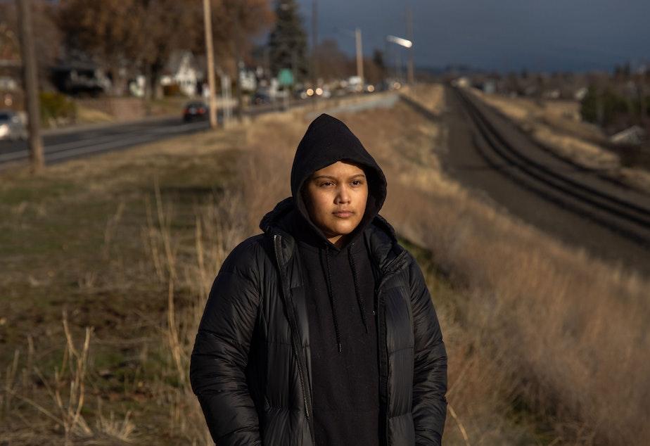 caption: Michelle Aguilar Ramirez walks around her new neighborhood in Spokane, Washington.