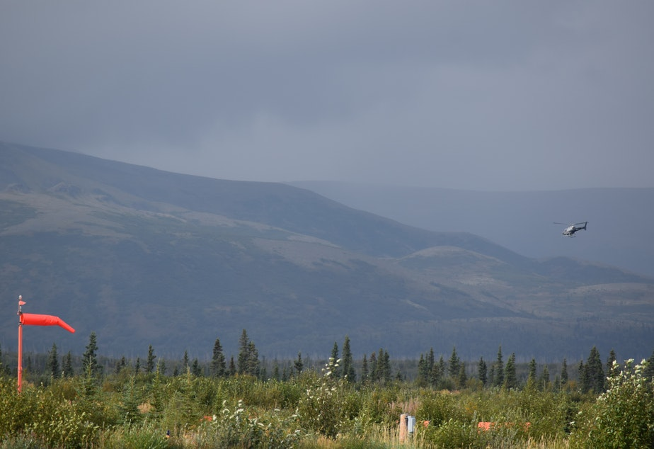 A helicopter flies above the proposed Pebble mine site, near the headwaters of the Bristol Bay watershed.