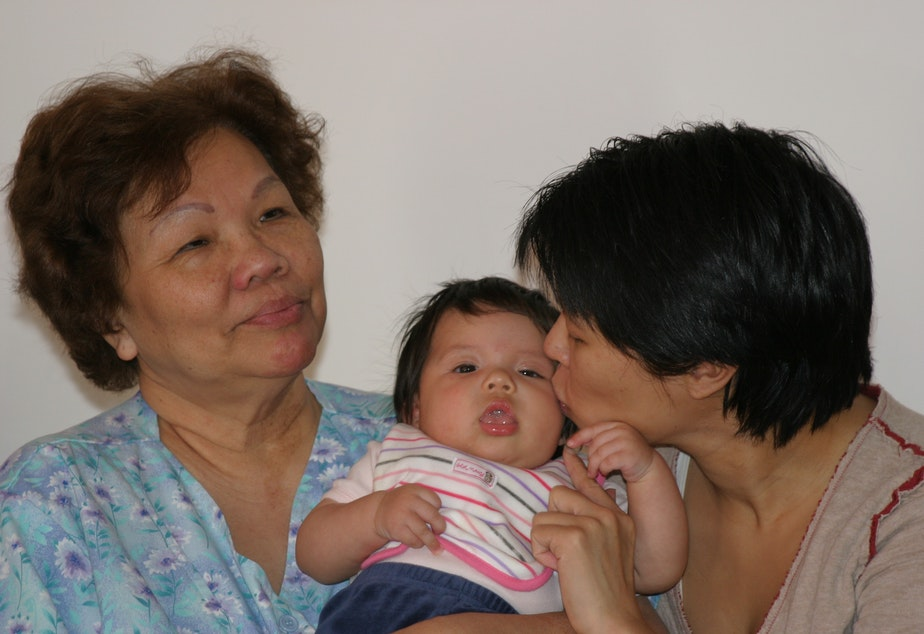 caption: Three generations of a Filipino-American family in Seattle: Erlinda Conde (left) with her granddaughter Charlotte Engrav and daughter Teresa Engrav.