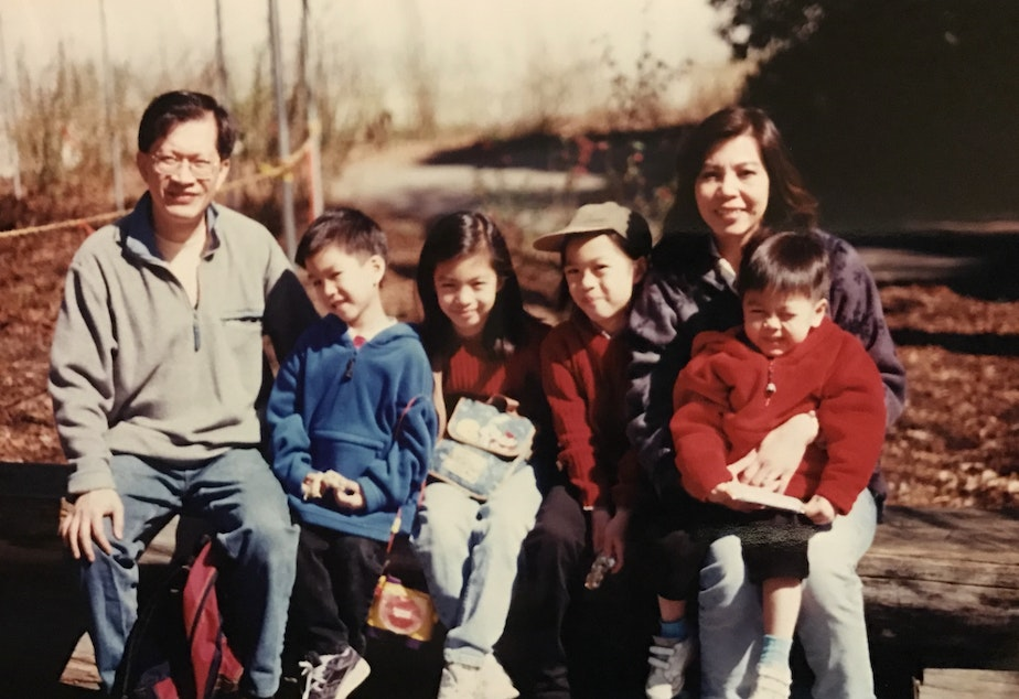 caption: Simon Tran with his family on a camping trip at the Olympic National Park, 1998. From left: Simon's dad Luong, Simon, Christina (eldest sister), Michelle (second eldest sister), Simon's mom My Trang, Francis (brother).