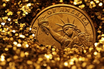 Liberty, buried in gold.