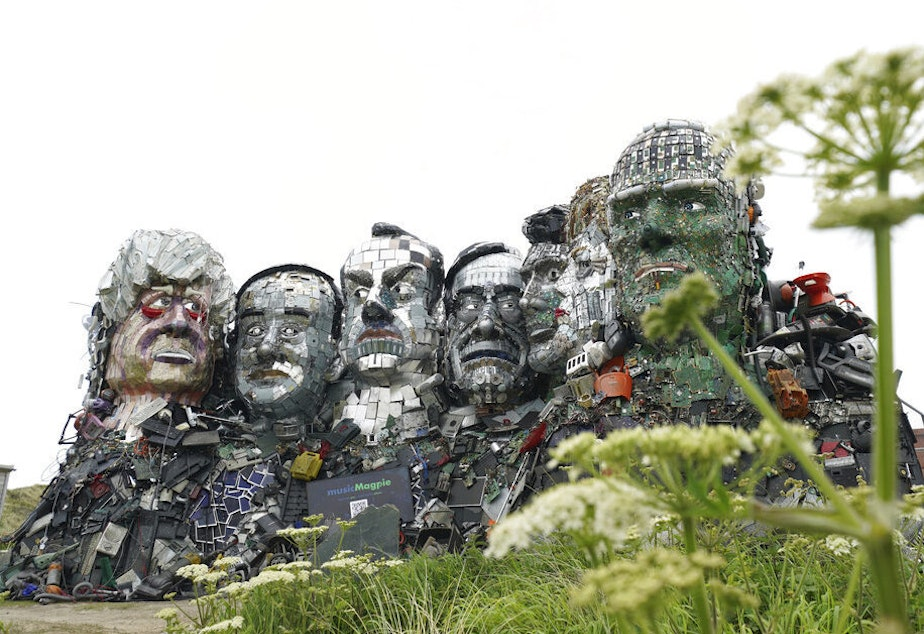 caption: A sculpture created out of electronic waste in the likeness of Mount Rushmore and the G-7 leaders sits on a hill in Cornwall, England, near where the leaders of the world's wealthiest nations will meet.