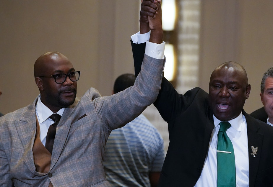 caption: Philonise Floyd (left) and attorney Ben Crump react after a guilty verdict was announced at the trial of former Minneapolis police Officer Derek Chauvin for the murder of Floyd's brother George Floyd