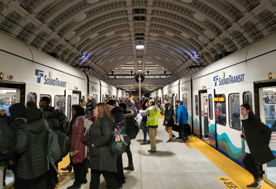 caption: Seattle commuters transfer trains on the first workday of the new year on Monday, January 6th, 2020.