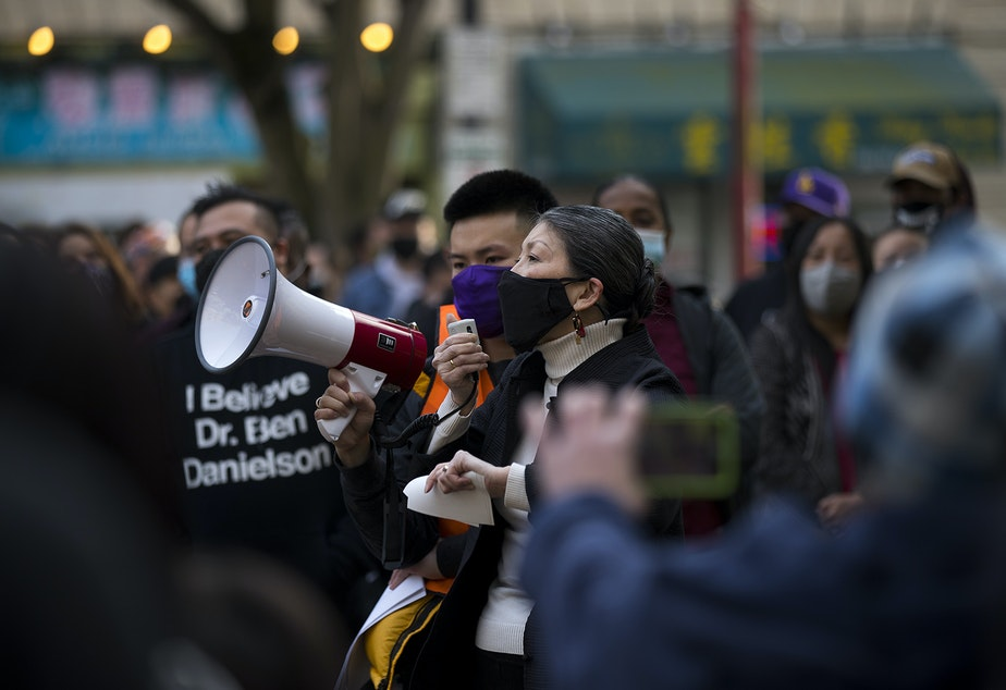 caption: Sharon Tomiko Santos, a member of the Washington House of Representatives for the 37th legislative district, speaks to the crowd with a megaphone during the 'We Are Not Silent' rally against anti-Asian hate and violence on Saturday, March 13, 2021, at Hing Hay Park in Seattle. Several days of actions are planned by rally organizers in the Seattle area following recent attacks and violence against Asian American and Pacific Islander communities.