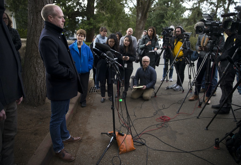 caption: Kevin Connolly speaks to the press outside of the Life Care Center of Kirkland on Thursday, March 5, 2020, in Kirkland.