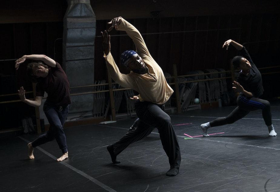 caption: Dancers including Mikhail Calliste, center, rehearse on Monday, September 17, 2018, at Spectrum Dance Theater in Seattle.