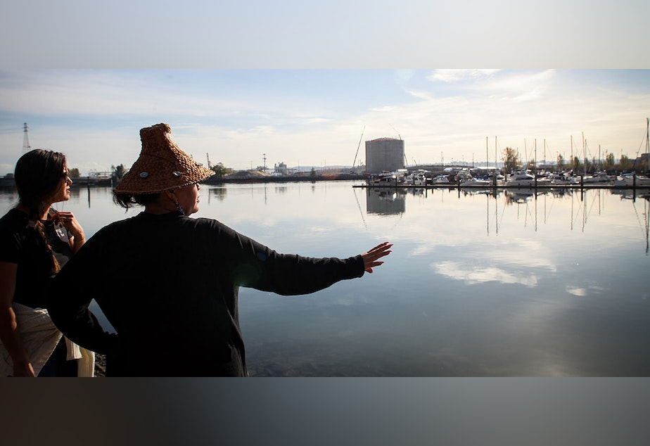 Tribal members on Tacoma's Hylebos Waterway with the Puyallup tribal marina and Tacoma LNG plant in the background.