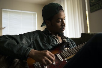 Lamont Hendrix, banker and musician, at his home in Seattle.