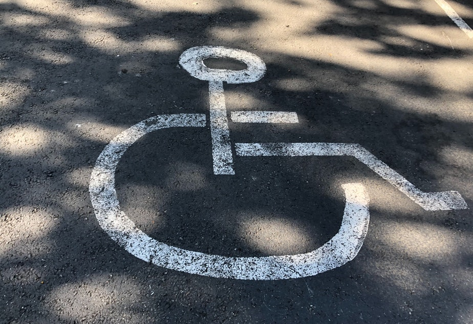 caption: Disability rights advocates worry that businesses will use disability parking for outdoor dining or retail space.