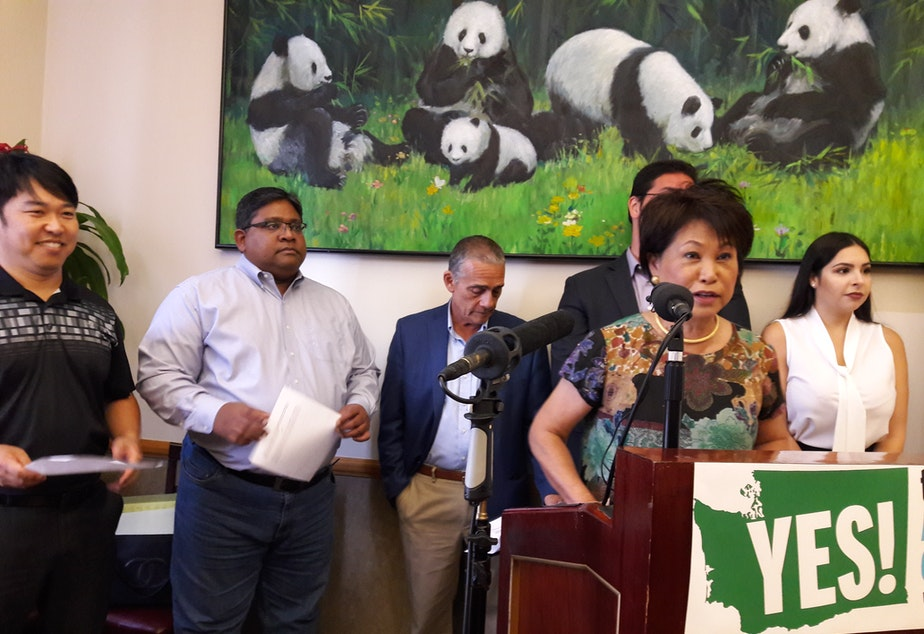 Martha Lee, president of the Ethnic Chambers of Commerce, announces the group's support of I-1634.