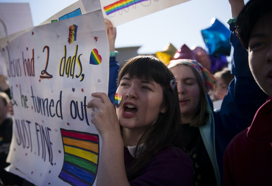 caption: Violet Fitzgerald, a 16-year-old sophomore at Kennedy Catholic High School chants during a student walkout to protest the departure of two LGBT educators on Tuesday, February 18, 2020, in Burien.