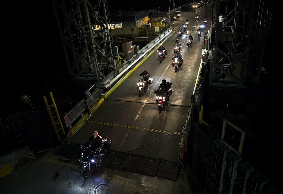 caption: Motorcyclists drive onto a ferry in Southworth at 4:00 a.m. on Wednesday, June 12, 2019, heading to the Fauntleroy Terminal in West Seattle.