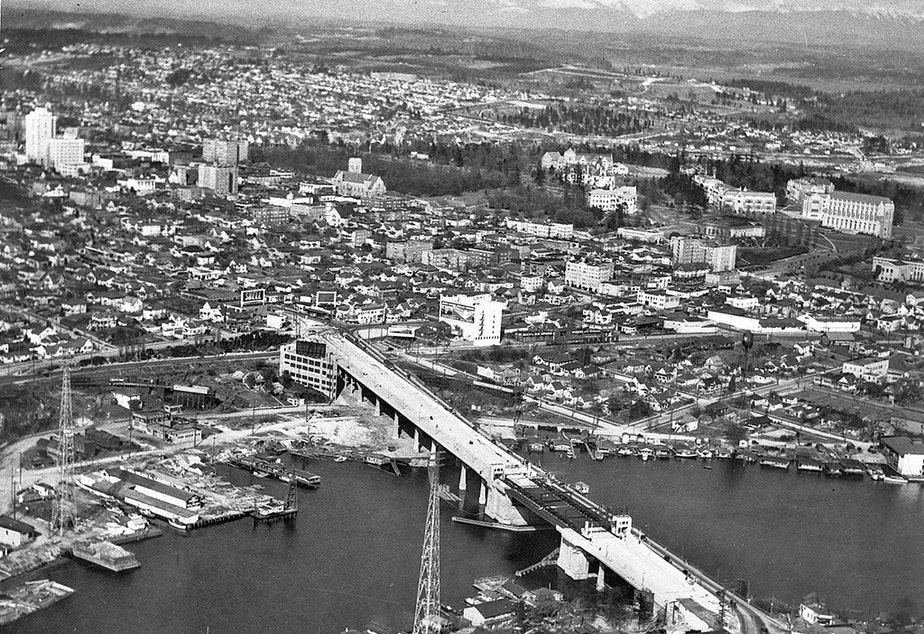 caption: In 1933, the University Bridge was under construction. In a couple of years, the district will have a Sound Transit train running through to downtown Seattle.