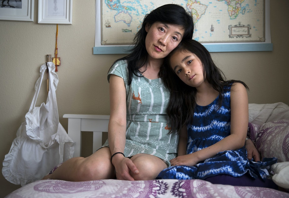 """caption: Katherine Lee with her 8-year-old daughter Ellie Stearns in Seattle. """"She was hungry a lot. She had a hunger cry, which is different from discomfort cry or 'I'm tired' cry. That triggered panic in my brain. It was always frantic. I started supplementing with formula. That was crushing. I know there are some parents, 'Oh yeah, we supplement.' Looking back, I can see how some people can say it's not such a huge deal, don't worry about it, but say that to a mom who is in a constant state of panic."""""""