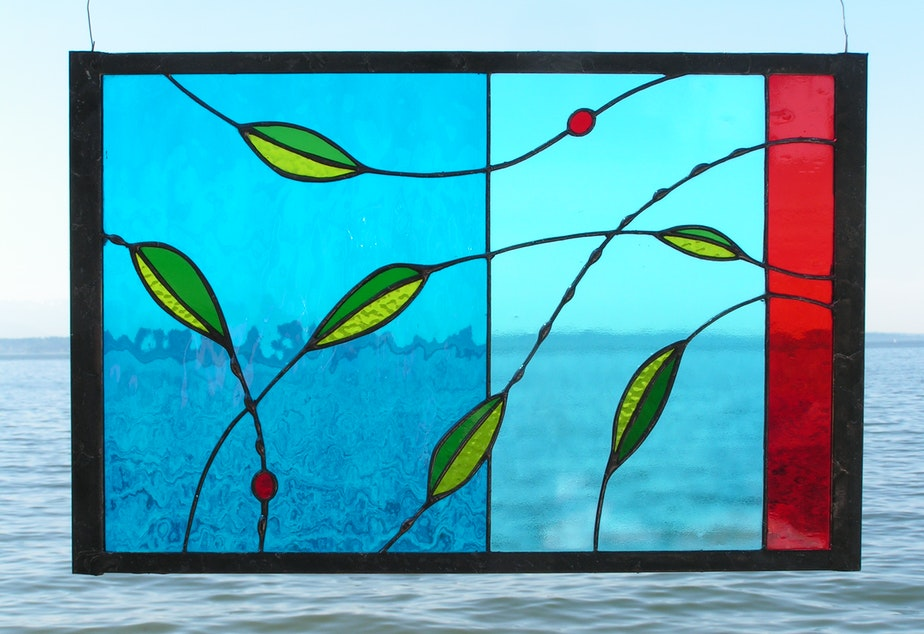 caption: Joby Shimomura's stained glass work at Alki Beach in West Seattle.