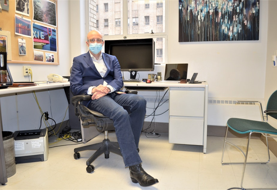 caption: Dr. Aaron Bunnell sits in his office at Harborview's Covid clinic on February 5, 2021.