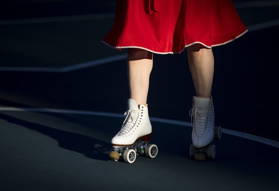 caption: Melinda Davis skates during a decades themed skate meet up on Tuesday, October 6, 2020, at the White Center Bicycle Playground in Seattle.