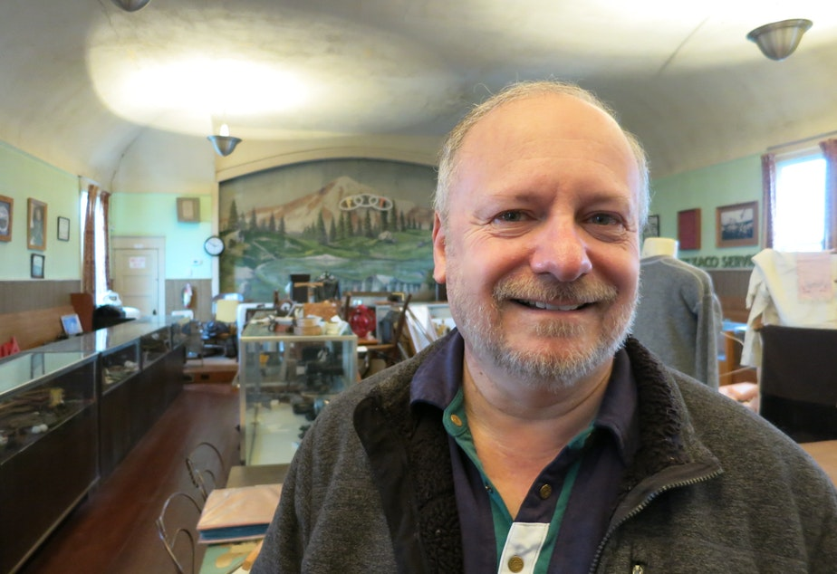 caption: Richard Kennedy edited a book of Des Moines-area history. He poses inside the Des Moines Historical Society's museum.