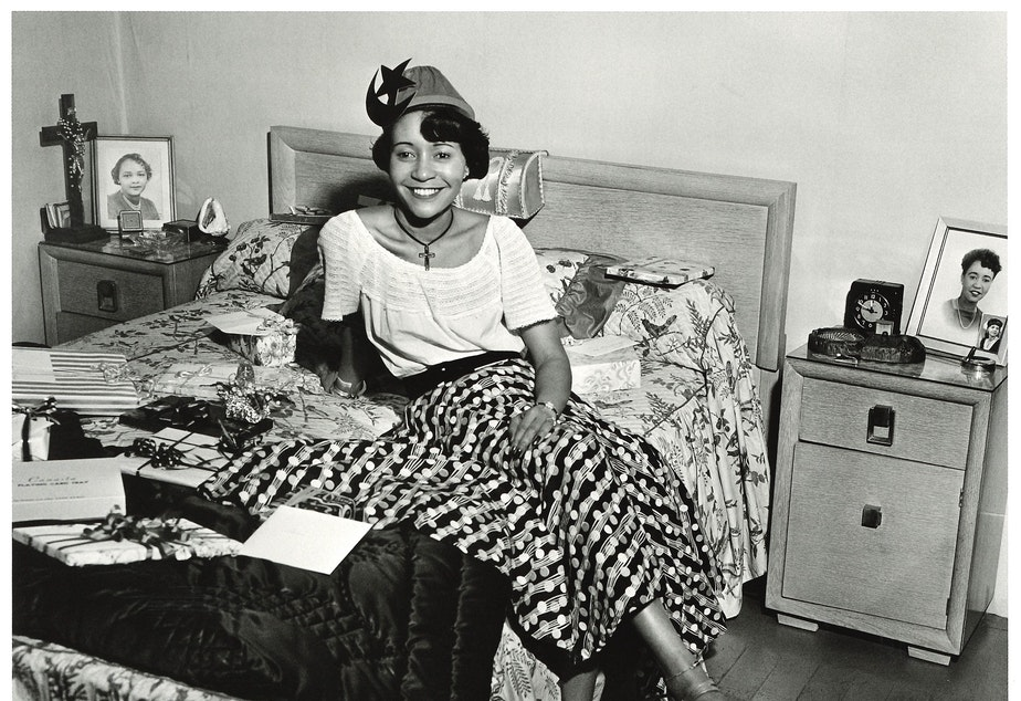 An unidentified hostess from a house party in Seattle's Central District, around 1950. Photographer Al Smith took tens of thousands of photos, many in Seattle's Central District, the heart of the city's African-American community. (To help us ID individuals, note the photo number. This is #1.)