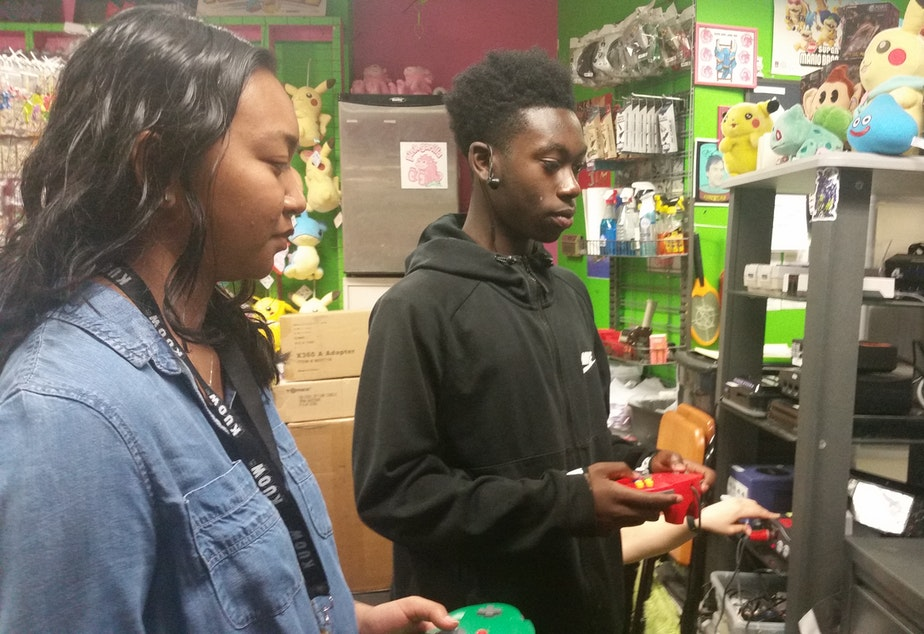 caption: Annika Prom and Tre'vion Sinclair enjoying Nintendo 64 even though they're very serious. (It's more than a game. It's a lifestyle.)