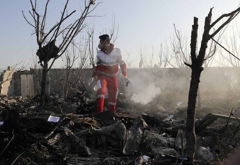 A rescue worker searches the scene where a Ukrainian plane crashed near Tehran on Wednesday, killing all on board. Iranian state TV reported Saturday that the military mistakenly shot the plane down.