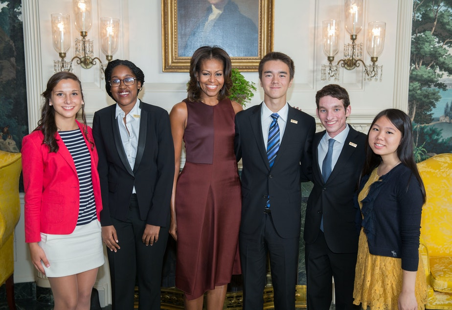 caption: First Lady Michelle Obama with the 2013 National Student Poets (from left: Michaela Coplen; Sojourner Ahebee, Nathan Cummings, Louis Lafair, and Aline Dolinh) in the Diplomatic Reception Room of the White House, Sept. 20, 2013.