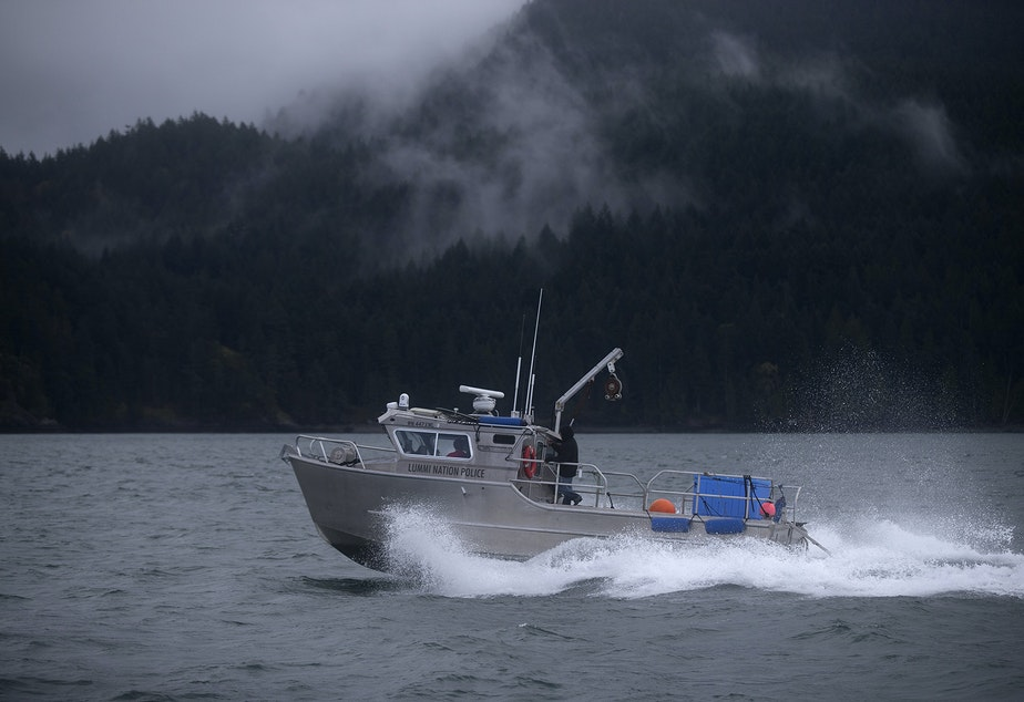 The Lummi Nation police boat returns to Squalicum Harbor after a ceremonial feeding for qwe 'lhol mechen, meaning the 'relatives that live under the sea', on Wednesday, April 10, 2019, in the waters west of Bellingham.