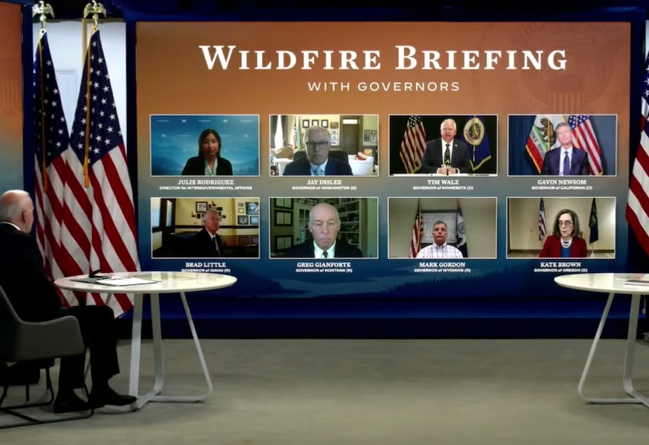 caption:  President Joe Biden and Vice President Kamala Harris attend a virtual wildfire briefing with seven governors.