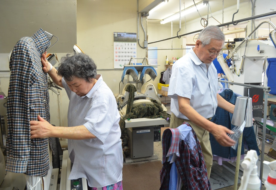 Hyen Sook Kang and Tae Park work in their Wallingford business, Sun Dry Cleaners. They've switched to a wet cleaning process to avoid toxic dry cleaning chemicals.