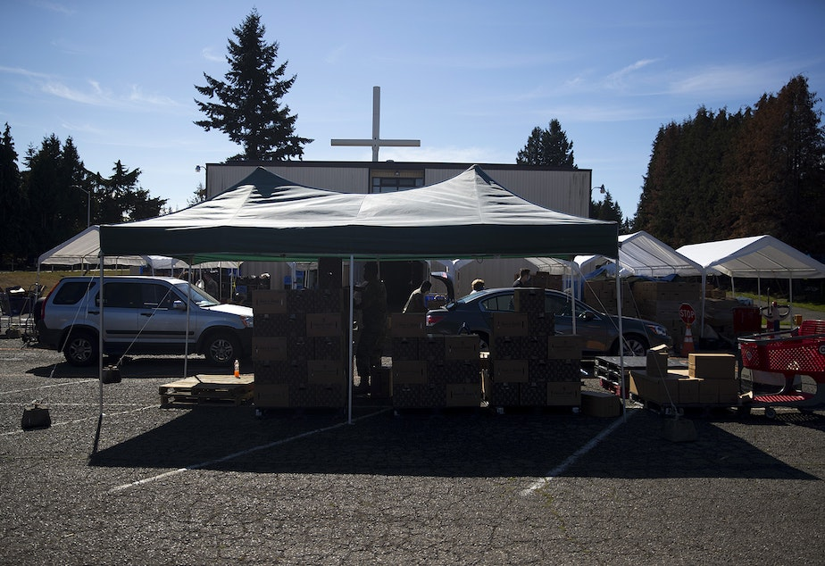 caption: Vehicles line up on Tuesday, September 22, 2020, at the Tukwila Pantry Food Bank on South 140th Street in Tukwila.