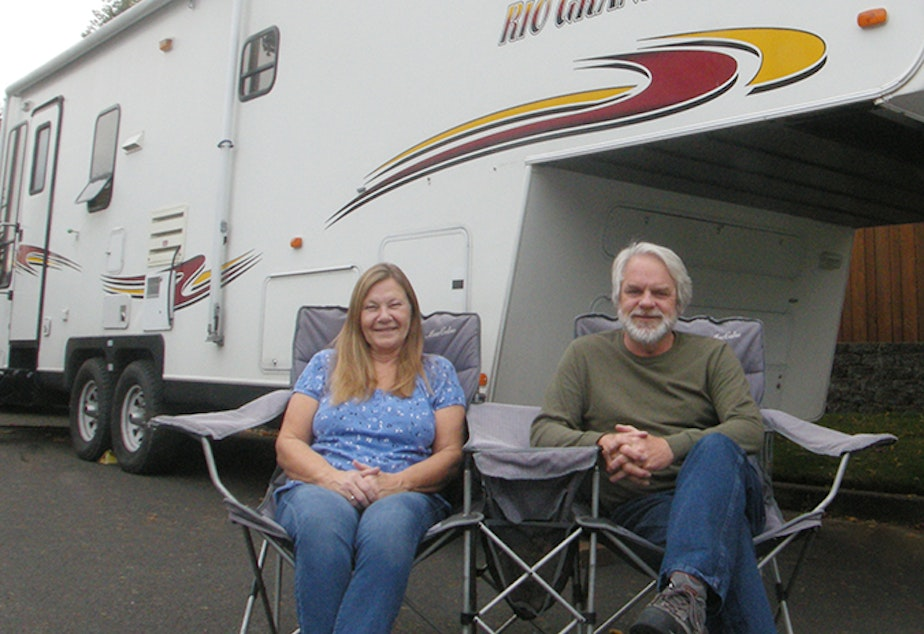 caption: Photographer Charlie Borland earned enough money through teaching online courses, he and his wife Barbara were able to buy an RV and sell their home in Bend, Ore.