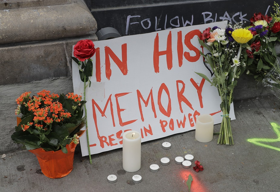 "caption: A sign that reads ""In his Memory Rest in Power,"" is displayed at a growing memorial to Lorenzo Anderson, Saturday, June 20, 2020, at the intersection of 10th Ave. and Pine St. near the Capitol Hill Occupied Protest zone in Seattle."
