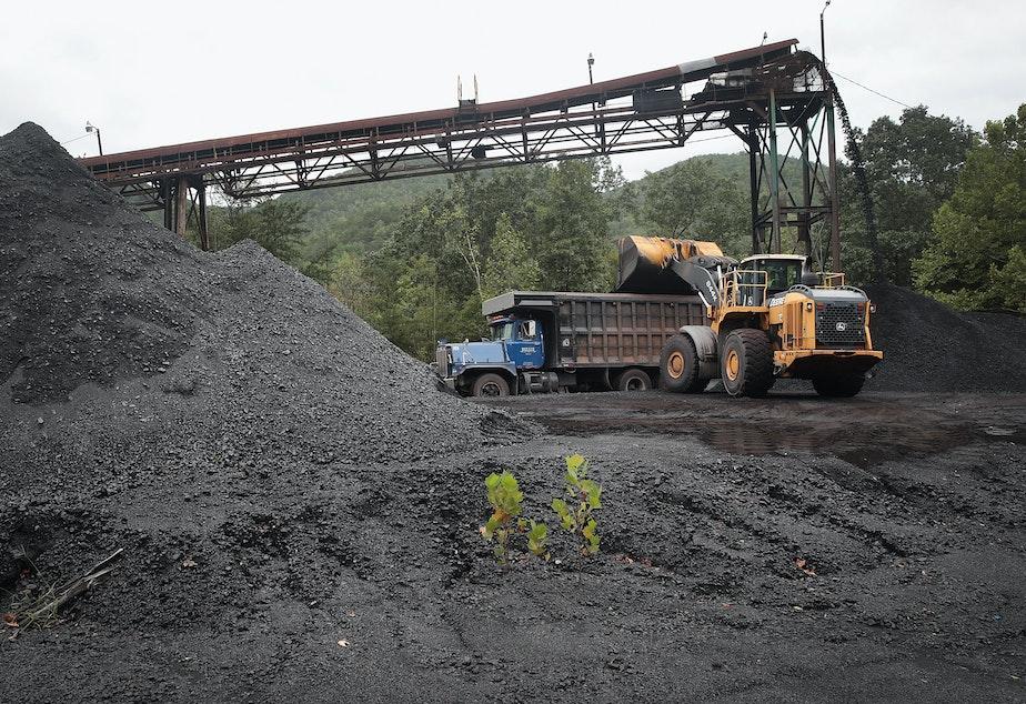 caption: A truck is loaded with coal at a mine on August 26, 2019 near Cumberland, Kentucky.