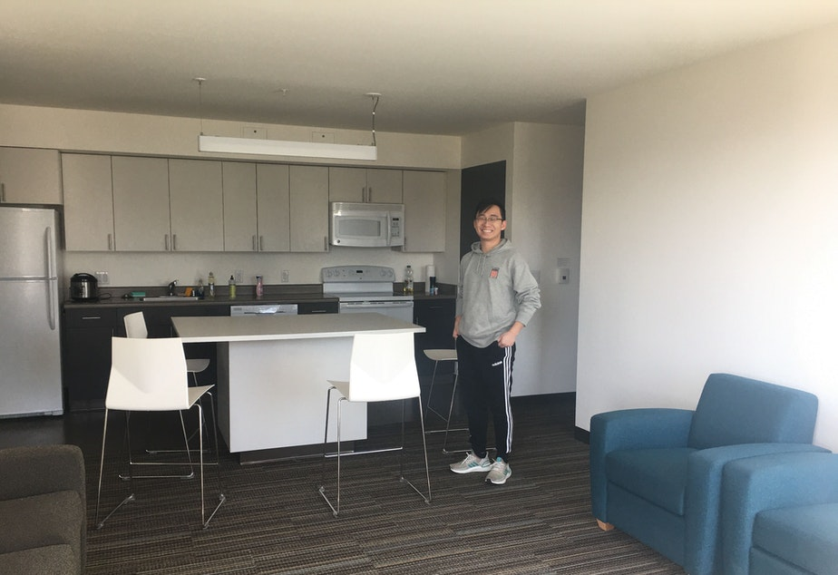 caption: UW sophomore Aaron Zhao in his apartment. His 3 other roommates have moved out already after the University of Washington opted to move spring quarter classes online. March 19, 2020.
