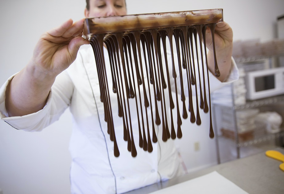 Karen Neugebauer, artisan chocolatier and owner of Forte Chocolates, pours melted chocolate from a truffle mold at her company's production shop in Mount Vernon. Click on this photo to see more images.