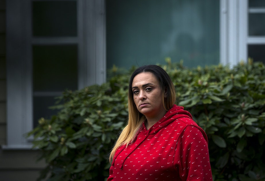 """caption: Kandis Mello stands for a portrait on Friday, May 1, 2020, at her home in Burien. """"I feel like I'm set up for failure,"""" said Mello. """"I would have rather stayed in prison and not put this burden on my family."""""""