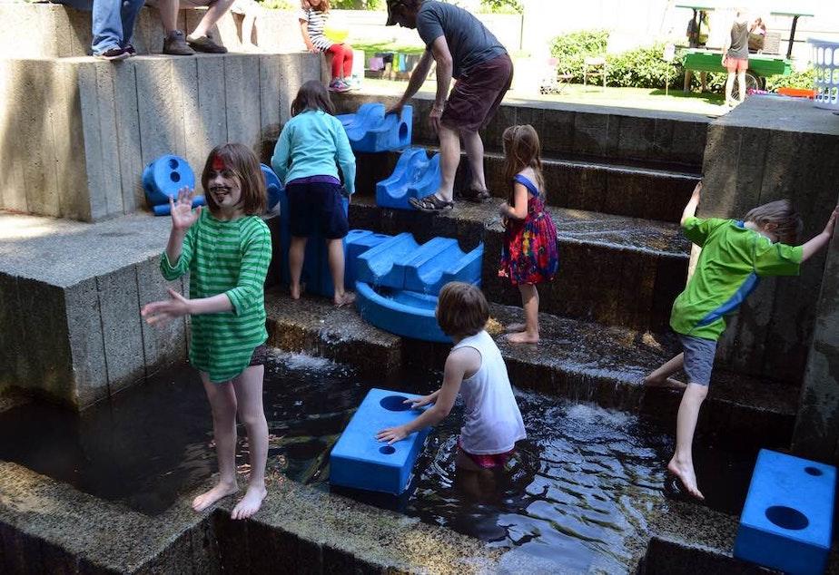 caption: File photo: Children splash in a fountain in Freeway Park in downtown Seattle.