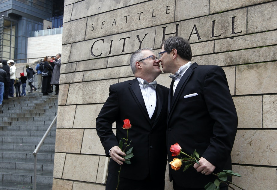 caption: Terry Gilbert, left, kisses his husband Paul Beppler after wedding at Seattle City Hall, becoming among the first gay couples to legally wed in the state, Sunday, Dec. 9, 2012, in Seattle.