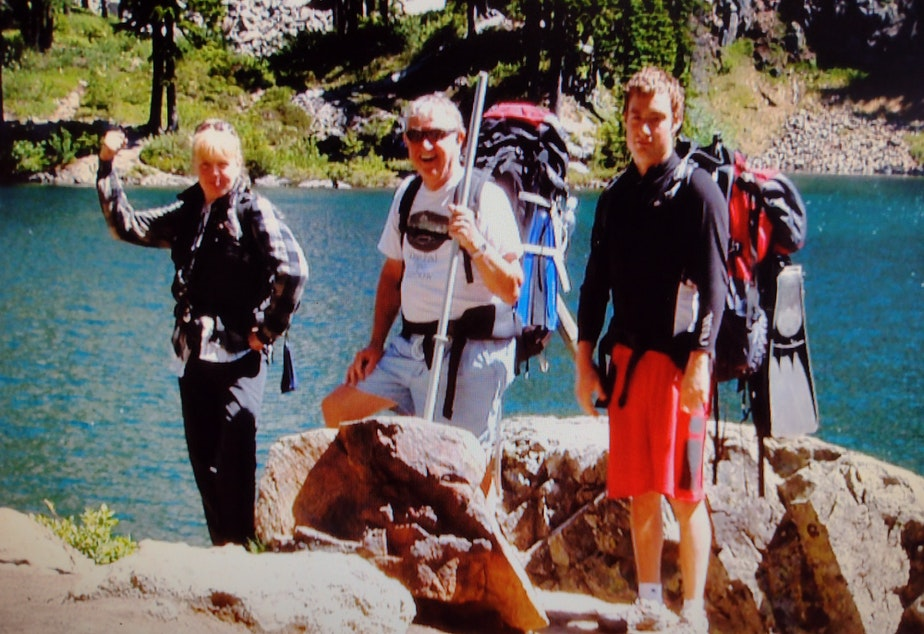 caption: Jerry Spring (center), pictured with daughter Vickie (left), and son Stephen during a 2006 hike.