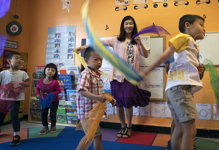 caption: Seattle Preschool Program teacher Hien Do, center, dances with her students on Wednesday, June 28, 2017, at the ReWA Beacon Hill Early Learning Center in Seattle.