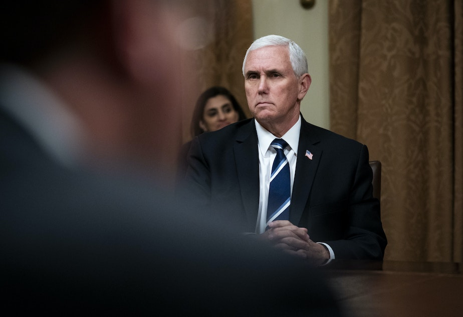 caption: WASHINGTON, DC - APRIL 27: U.S. Vice President Mike Pence listens during White House meeting with industry execs.