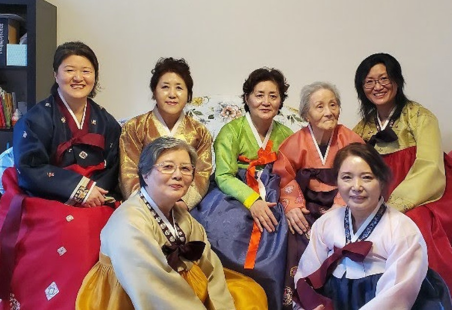 caption: Ruby Lee's grandma, mom, and great-aunts (from left: Andria Sueyoung Kim, Jackie Hyekoung Ro, Nancy Junghee Lee, Hae Ha Kwon, Eui Bun Lim, Haesook shin, and Sue Lim) during Korean New year in their hanboks, traditional Korean formal dresses.