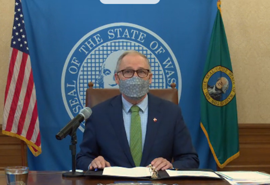 caption: Gov. Jay Inslee on Friday signed a $2.2B COVID relief measure into law.