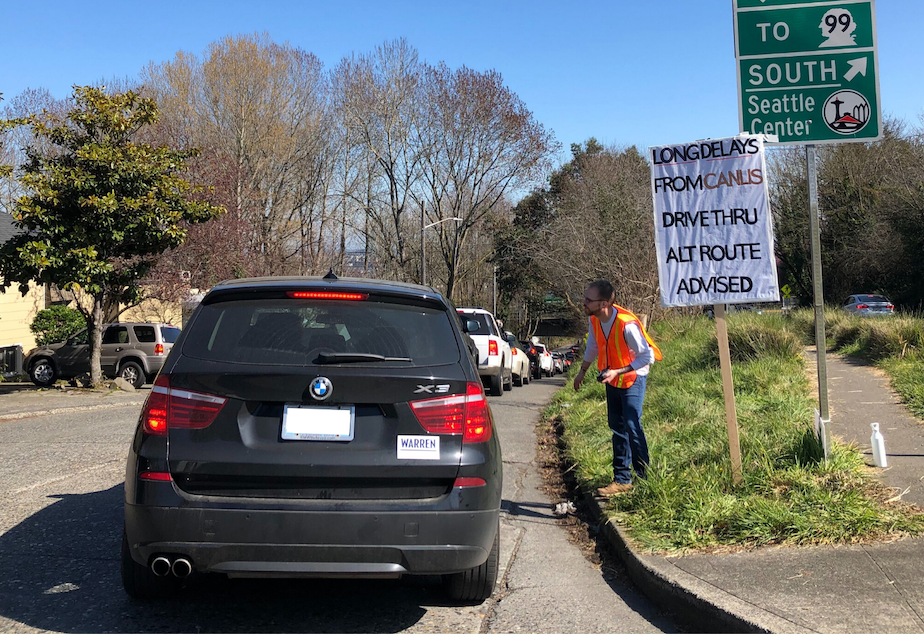 caption: The wait in line for drive-through food at Canlis was about 40 minutes on March 20, 2020.