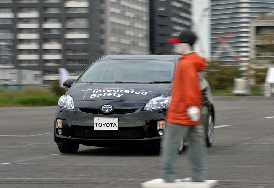 """Toyota demonstrates its """"pre-collision system,"""" which uses automatic steering in addition to automatic braking to prevent collisions, in Tokyo in 2013. Different manufacturers use different names for systems like this, which can be confusing, a AAA report found."""