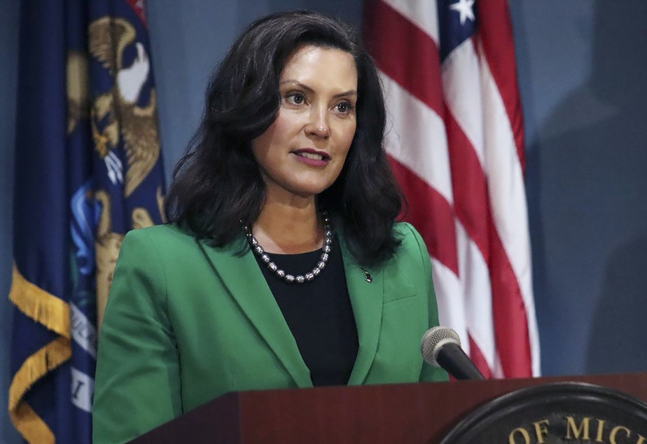 """caption: """"In the spring, we listened to public health experts, stomped the curve and saved thousands of lives together. Now, we must channel that same energy and join forces again to protect our families, frontline workers and small businesses,"""" Michigan Gov. Gretchen Whitmer said in a statement."""