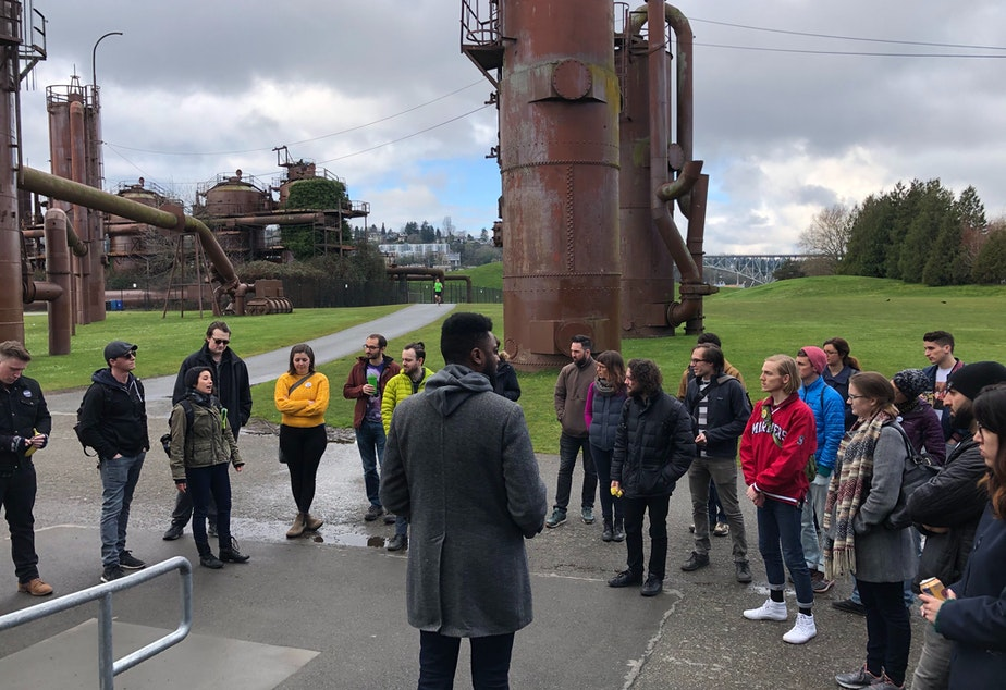 caption: Volunteers for the Bernie Sanders campaign met with field director Shaun Scott, center, before heading out from Gasworks Park on Sunday.